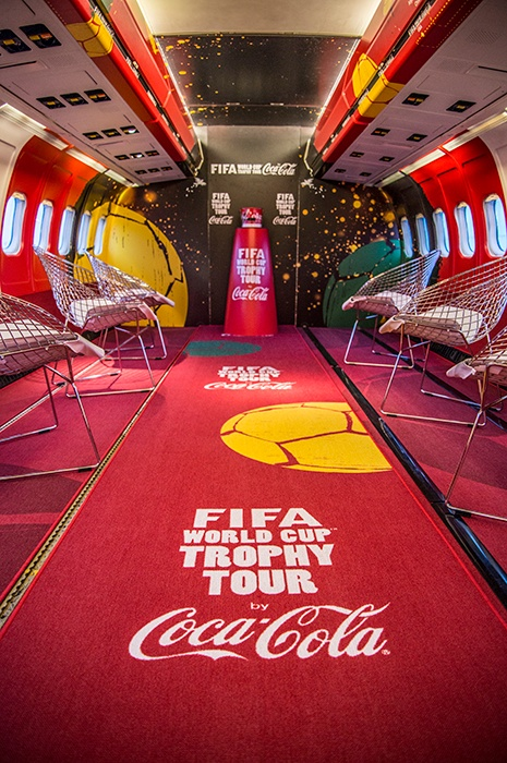 Transportation plane with FIFA world cup and Coca Cola carpet
