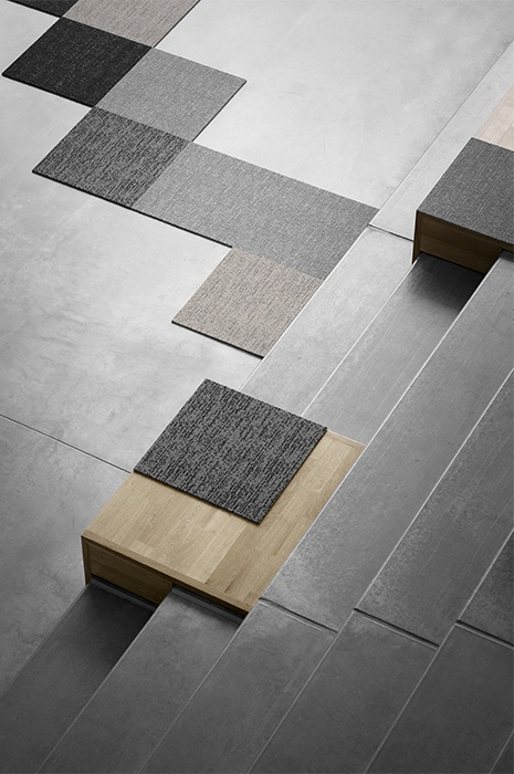 Carpet tiles laid out on a plain floor to show the great flexibility