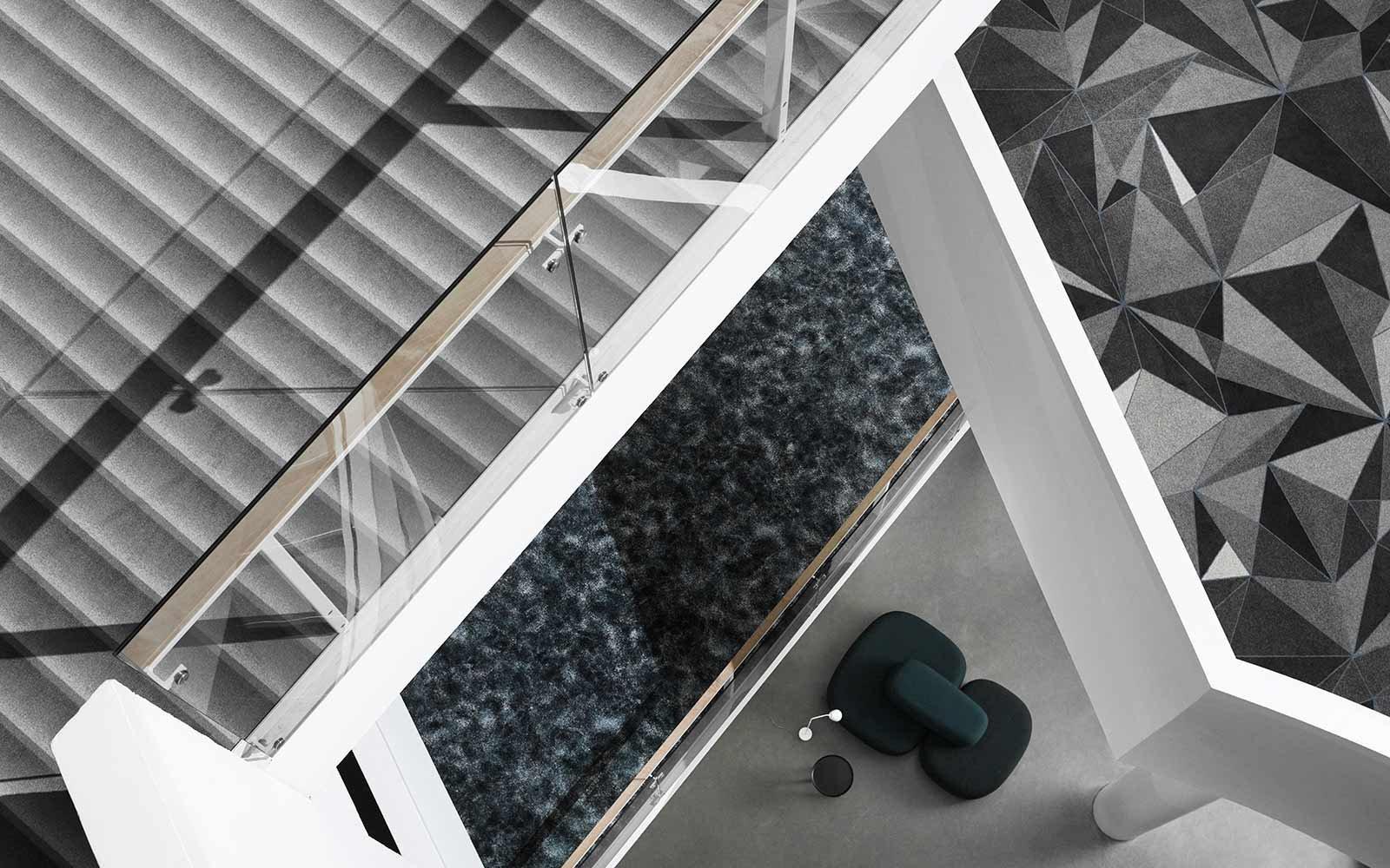 Teppich in Grautönen inspiriert von Beton, Glas und Metall